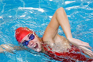 Swimmer wearing a swim cap